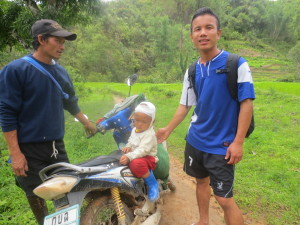 He led us across the entire rice field to where his son was sitting on his motorbike. He had fallen several days ago and received 15 sutures to the top of his head.  He was supposed to get a medical person to change the dressing every day and then take out the sutures....