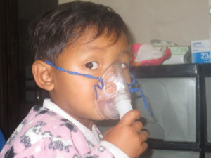 BrooMoo, the adorable 2 year old who is so used to his asthma and what I do that he comes and stands right in front of me, pulls his shirt up so I can listen to his lungs.  Lifts his arms so he can have his temperature taken, and when I am ready he takes the oxygen masks and holds it himself the entire 15 or 20 mins.  He kneels and prays with me and then shakes my hand as he leaves.  It is very hard for me to see him suffer with asthma because I love him so much.