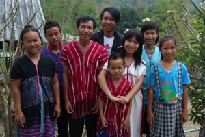 DJ's wife, RraeLu, far left.  DJ, center with his 6 children.