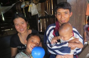 ShePaw, her husband and the 2 youngest of their 6 children.